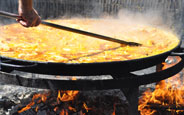 Cooking Paella On An Open Fire